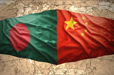 Waving Bangladesh and Chinese flags of the political map of the world photo