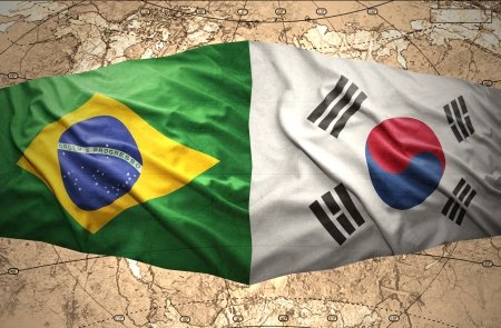 Waving Korean and Brazilian flags of the political map of the world photo