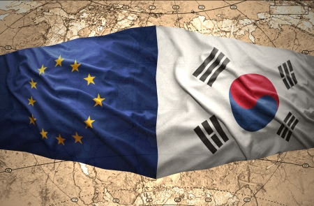 Waving Korean and European Union flags of the political map of the world photo