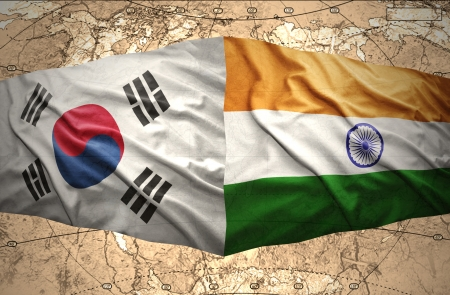 Waving Korean and Indian flags of the political map of the world photo
