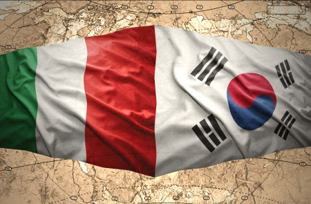 Waving Korean and Italian flags of the political map of the world photo