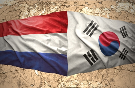 Waving Korean and Dutch flags of the political map of the world photo