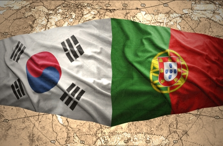 Waving Korean and Portuguese flags of the political map of the world photo