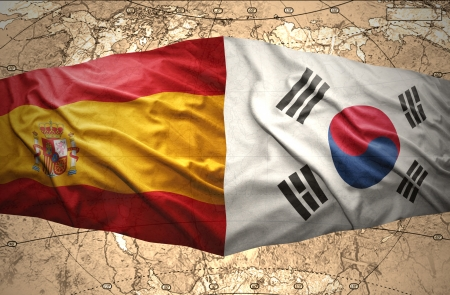 Waving Korean and Spanish flags of the political map of the world photo