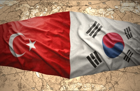 Waving Korean and Turkish flags of the political map of the world photo