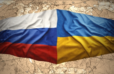 Waving Ukrainian and Russian flags of the political map of the world photo
