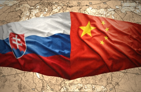 Waving Slovak and Chinese flags of the political map of the world Stock Photo