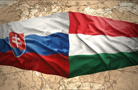 slovak: Waving Slovak and Hungarian flags of the political map of the world Stock Photo