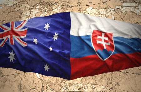 Waving Slovak and Australian flags of the political map of the world photo