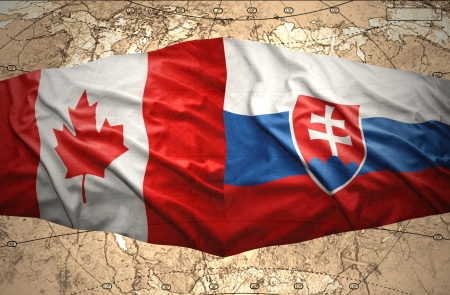 slovak: Waving Slovak and Canadian flags of the political map of the world