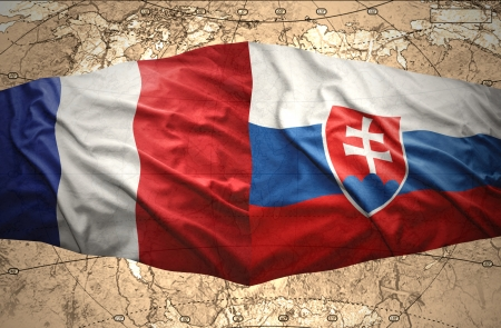slovak: Waving Slovak and French flags of the political map of the world Stock Photo