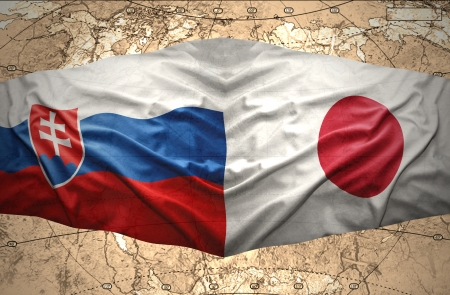 slovak: Waving Slovak and Japanese flags of the political map of the world