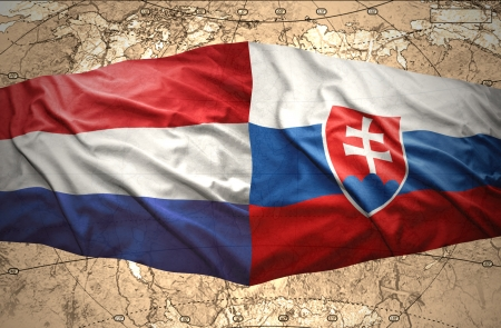 Waving Slovak and Dutch flags of the political map of the world photo