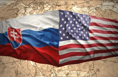 slovak: Waving Slovak and American flags of the political map of the world Stock Photo