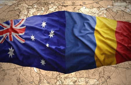 Waving Romanian and Australian flags of the political map of the world photo