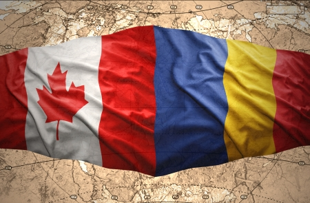 romanian: Waving Romanian and Canadian flags of the political map of the world
