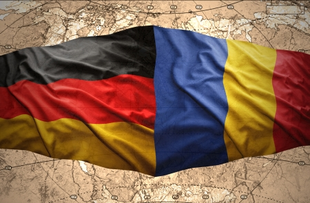 east berlin: Waving Romanian and German flags of the political map of the world