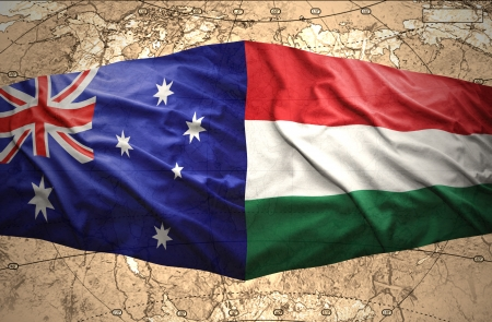 Waving Hungarian and  Australian flags of the political map of the world photo