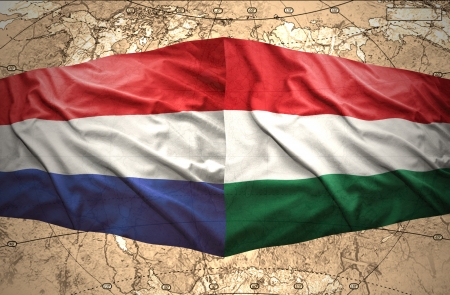 Waving Hungarian and Dutch flags of the political map of the world photo