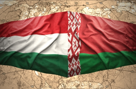 belorussian: Waving Hungarian and Belorussian flags of the political map of the world Stock Photo