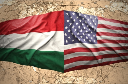 Waving Hungarian and American flags of the political map of the world photo