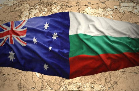 Waving Bulgarian and Australian flags of the political map of the world photo