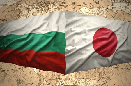 Waving Bulgarian and Japanese flags of the political map of the world photo