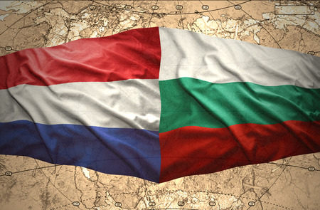 Waving Bulgarian and Dutch flags of the political map of the world photo