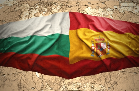 Waving Bulgarian and Spanish flags of the political map of the world photo