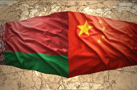 belorussian: Waving Belorussian and Chinese flags of the political map of the world Stock Photo