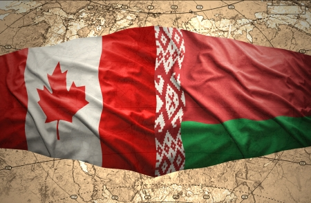 belorussian: Waving Belorussian and  Canadian flags of the political map of the world Stock Photo