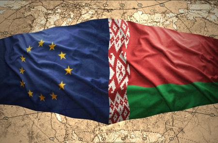 belorussian: Waving Belorussian and European Union flags of the political map of the world