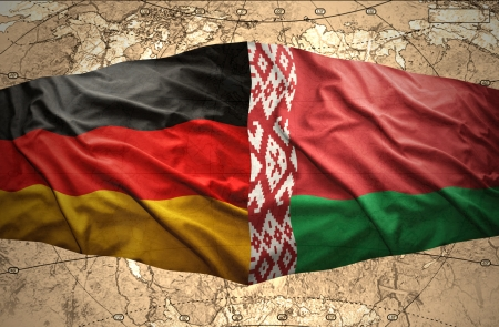 belorussian: Waving Belorussian and German flags of the political map of the world
