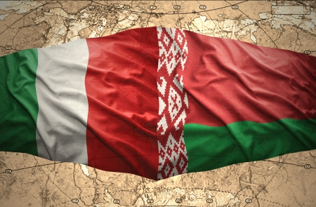 belorussian: Waving Belorussian and Italian flags of the political map of the world Stock Photo