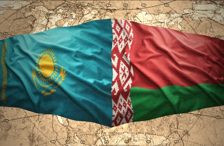 Waving Belorussian and Kazakh flags of the political map of the world photo