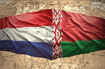 belorussian: Waving Belorussian and Dutch flags of the political map of the world