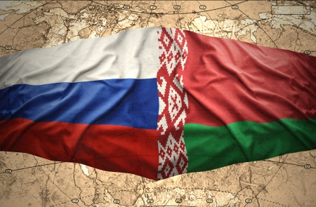 belorussian: Waving Belorussian and Russian flags of the political map of the world Stock Photo