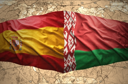belorussian: Waving Belorussian and Spanish flags of the political map of the world Stock Photo