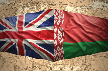 belorussian: Waving Belorussian and British flags of the political map of the world