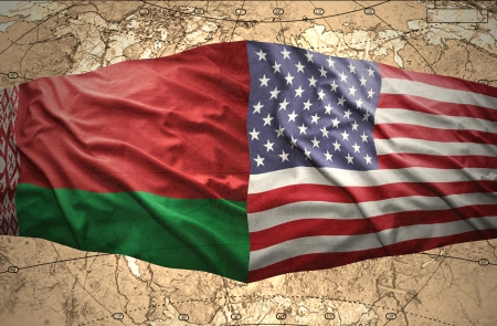 belorussian: Waving Belorussian and American flags of the political map of the world Stock Photo