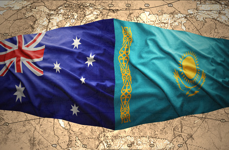 Waving Kazakh and Australian flags of the political map of the world photo
