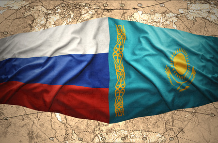 Waving Kazakh and Russian flags of the political map of the world photo