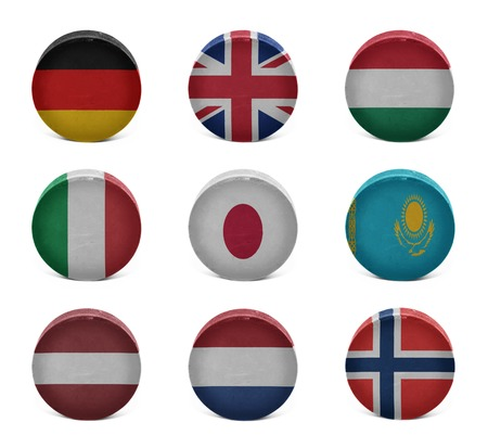 Vintage old hockey pucks with the German, British, Hungarian, Italian, Japanese, Kazakh, Latvian, Dutch, Norwegian national flags on a white background photo