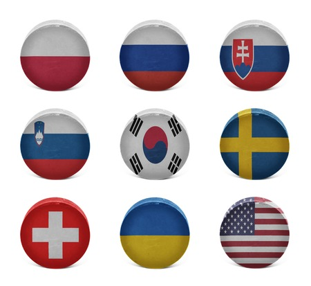 Vintage old hockey pucks with the Polish, Russian, Slovak, Slovenian, Korean, Swedish, Swiss, Ukrainian, American national flags on a white background photo