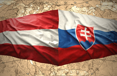 slovak: Waving Austrian and Slovak flags of the political map of the world
