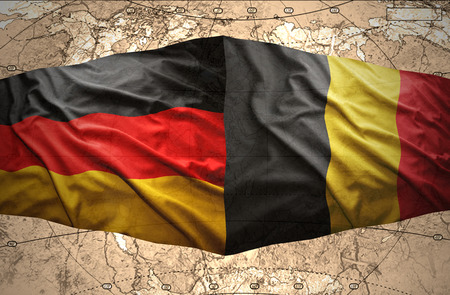 east berlin: Waving Belgian and German flags of the political map of the world