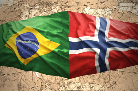 Waving Norwegian and Brazilian flags of the political map of the world photo