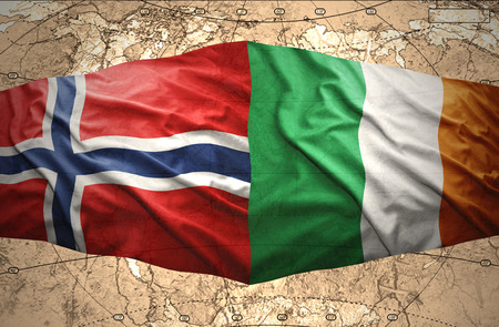 Waving Norwegian and Irish flags of the political map of the world photo