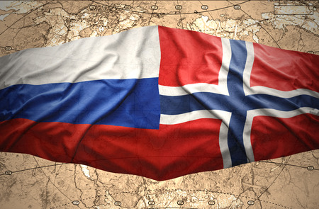 Waving Norwegian and Russian flags of the political map of the world photo