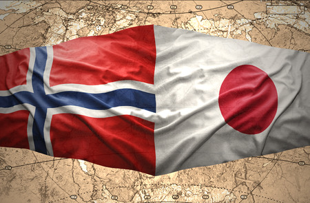 Waving Norwegian and Japanese flags of the political map of the world photo